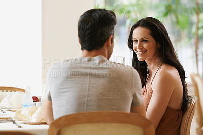 Buy stock photo A young couple on a date at a restaurant