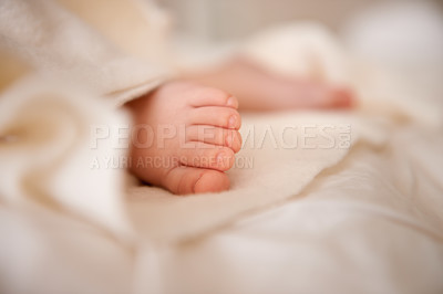 Buy stock photo Cropped shot a baby sleeping in bed