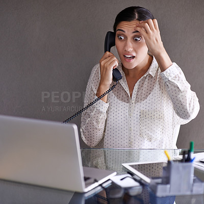 Buy stock photo Shot of a beautiful young woman having a stressful day at work