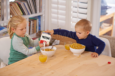 Buy stock photo Shot of a young brother and sister making breakfast at home