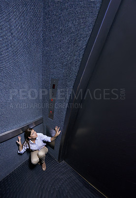 Buy stock photo Distorted shot of a young woman trapped in an elevator