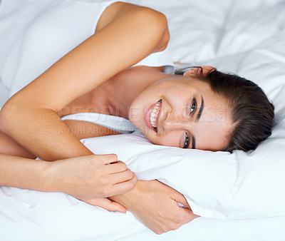 Buy stock photo Portrait of an attractive young woman lying in bed