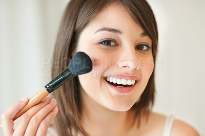 Buy stock photo Lovely young woman applying make up on her face