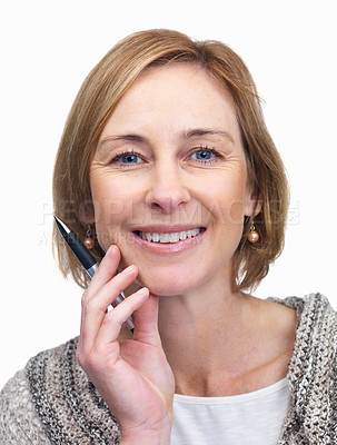 Buy stock photo Happy mature woman with a pen in hand over white b