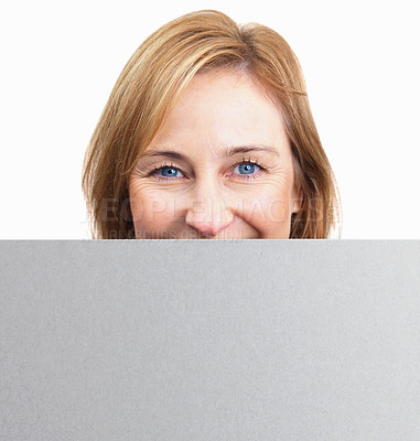 Buy stock photo Happy mature woman holding a blank board in front