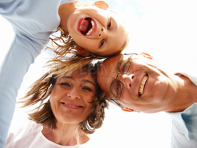 Low angle view of a happy grandparents and granddaughter