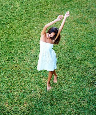 Buy stock photo Full-length brunette dancing outdoors