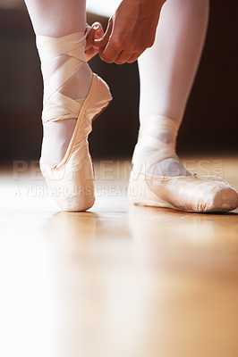 Buy stock photo Closeup portrait of a female ballet dancer putting on performance shoes