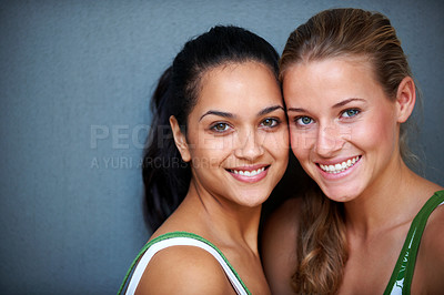 Buy stock photo Portrait of cute young women smiling together against grey background