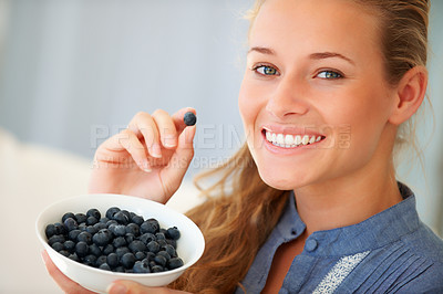 Buy stock photo Portrait of happy caucasian woman eating blackberries at home - Indoors