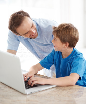 Buy stock photo Portrait of a happy young father and son working together on laptop - Indoor
