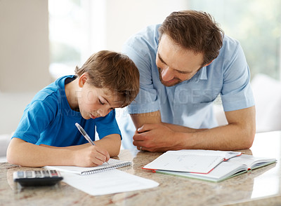 Buy stock photo Portrait of a happy man helping his son to do homework - Indoor
