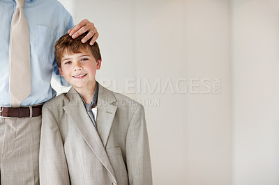 Buy stock photo Portrait of a cute little kid wearing an oversized coat standing with his father - Copyspace
