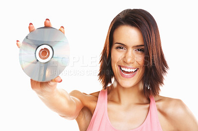 Buy stock photo Young excited beautiful woman holding out a CD isolated on white background