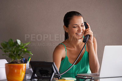 Buy stock photo Cropped shot of a young woman taking a business call in her office