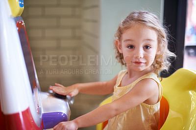 Buy stock photo An adorable little girl playing games indoors