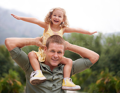 Buy stock photo A young girl on her dad's shoulders