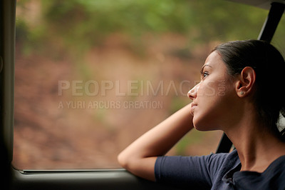 Buy stock photo A beautiful woman looking out of a car window