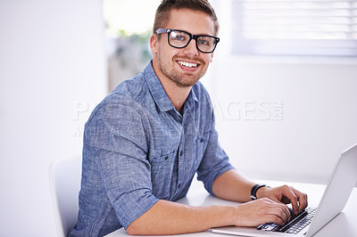 Buy stock photo A young creative businessman using his laptop