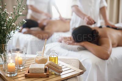 Buy stock photo Shot of a mature couple enjoying a hot stone treatment