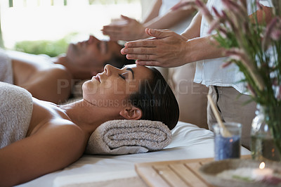 Buy stock photo Shot of a mature couple enjoying a relaxing massage