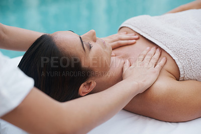 Buy stock photo Cropped shot of an attractive woman enjoying a massage beside a pool at a spa