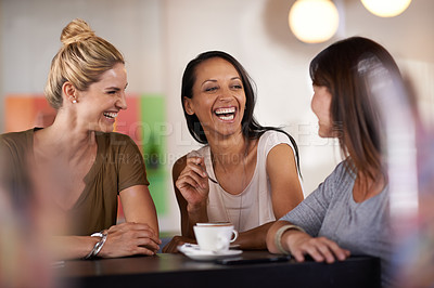 Buy stock photo Shot of three women enjoying a conversation in a restaurant