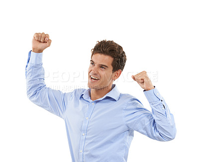 Buy stock photo Shot of a handsome young man in a studio raising his arms in celebration