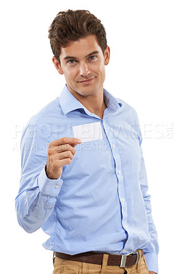 Buy stock photo Portrait of a handsome young man in a studio holding out a business card