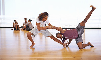 Buy stock photo Shot of two young dancers rehearsing together in a studio