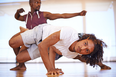 Buy stock photo Shot of two young men practicing in a dance studio