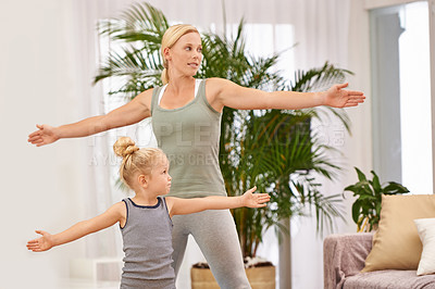 Buy stock photo Full length shot of a mother and daughter doing yoga together