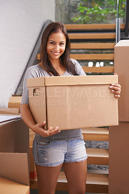 Buy stock photo Shot of a young woman into a new house