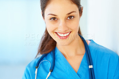 Buy stock photo Closeup of young female doctor giving you cute smile