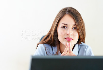 Buy stock photo Closeup of young thoughtful businesswoman working on computer