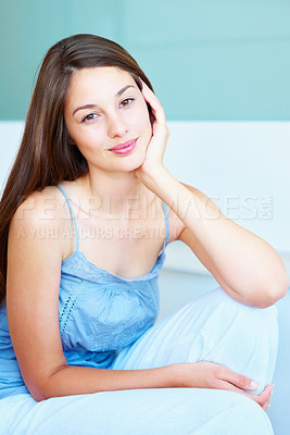 Buy stock photo Portrait of young girl with hand on face giving you warm smile