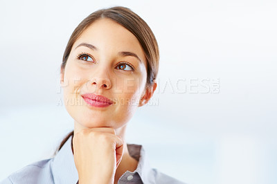 Buy stock photo Closeup of happy young business woman looking away and daydreaming