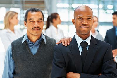 Buy stock photo Executive standing with arms crossed and colleague resting hand on shoulder