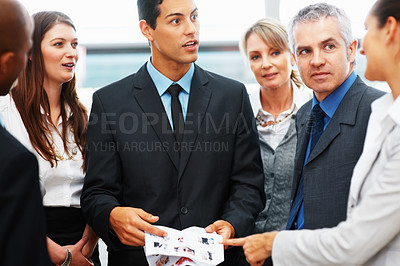 Buy stock photo Multi ethnic business colleagues having a discussion