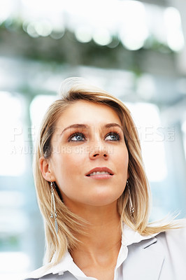 Buy stock photo View of female executive looking into distance