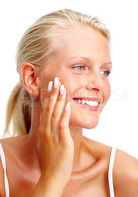 Buy stock photo Closeup of a cute young woman touching her face , smiling over white background