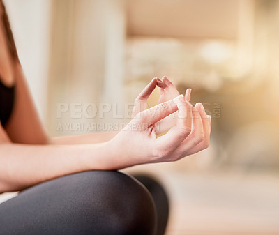 Buy stock photo Shot of an unrecognizable young woman meditating outside