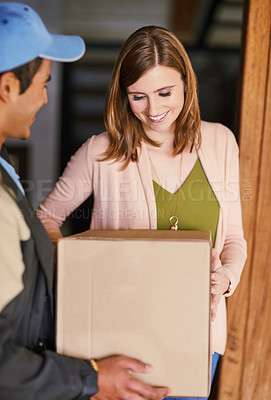 Buy stock photo Cropped shot of a courier making a delivery to a customer at her home