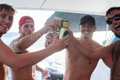 Buy stock photo Portrait of a group of guys drinking beer while on a boat at sea