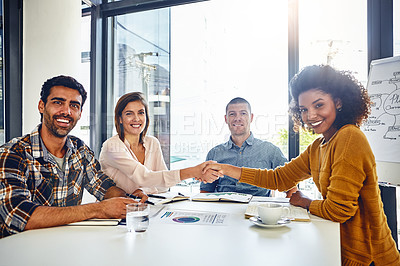 Buy stock photo Portrait of two designers shaking hands during a meeting in an office