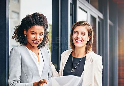 Buy stock photo Portrait of two businesswomen having a discussion outside an office