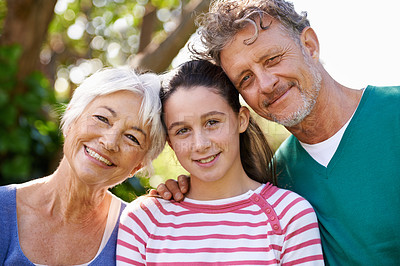 Buy stock photo Shot of grandparents and a young granddaughter