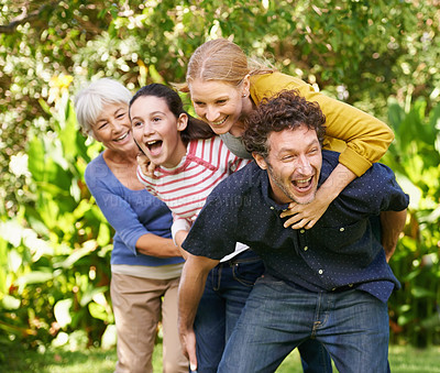 Buy stock photo Shot of a small family enjoying a day in nature