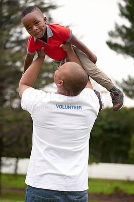 Buy stock photo Shot of volunteers working with little children