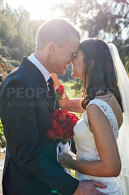 Buy stock photo Cropped shot of a bride and groom standing outside on their wedding day